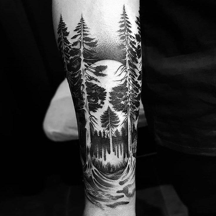 татуировка леса и черепа на руке