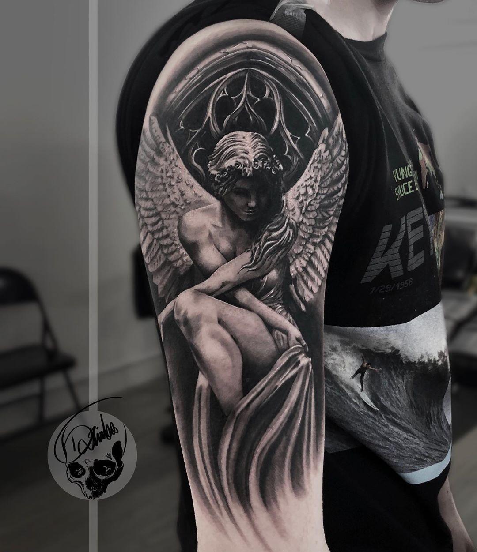 татуировка женщины ангела