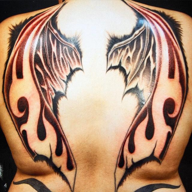 дьявольские крылья на спине тату