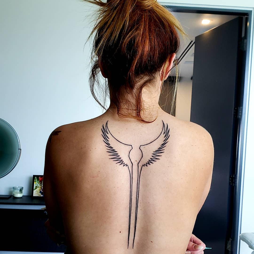 татуировка валькирии с крыльями
