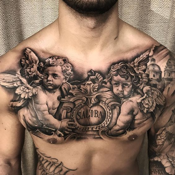 тату ангела на грудях