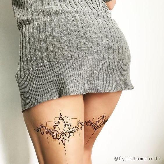 племенная татуировка лотоса на ноге