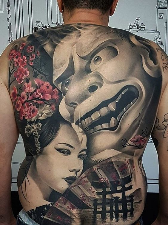 чоловіче тату на спині в японському стилі