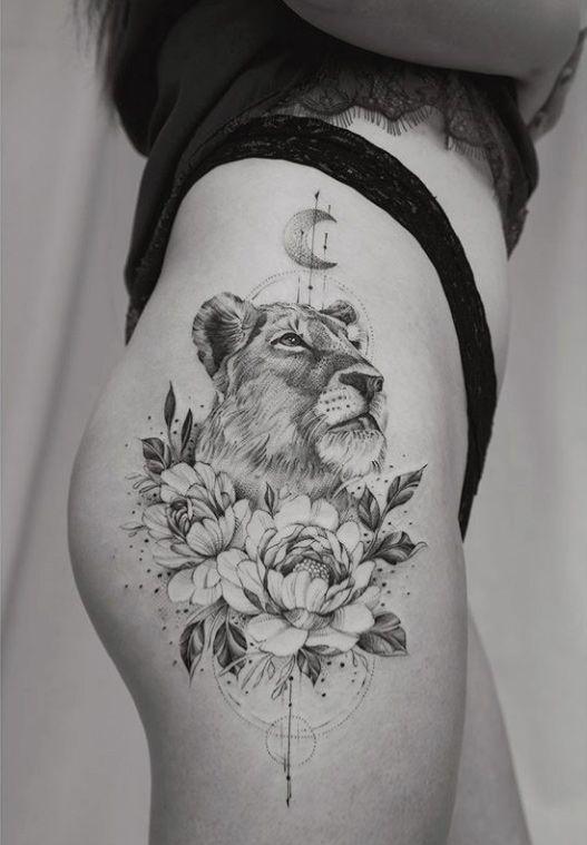 тату левиці на стегні