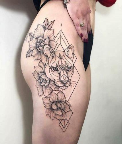жіноче татуювання тигра на стегні
