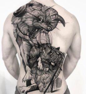тату двох вовків на спині