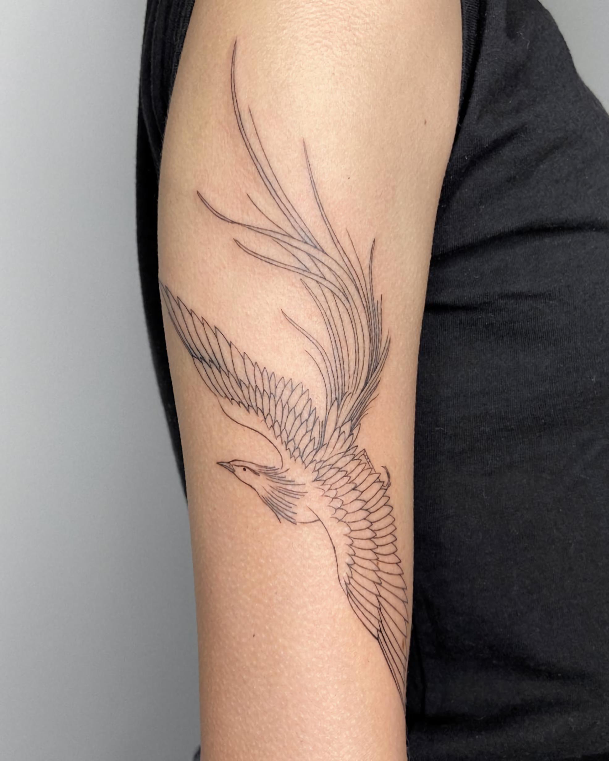 татуировка феникса на руке